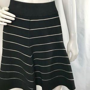 Torn by  Ronny Kobo black and white knit skirt.